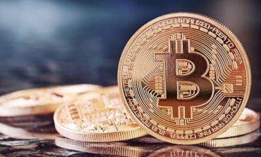 Bitcoin a atins un nivel record de peste 1.900 de dolari pe unitate